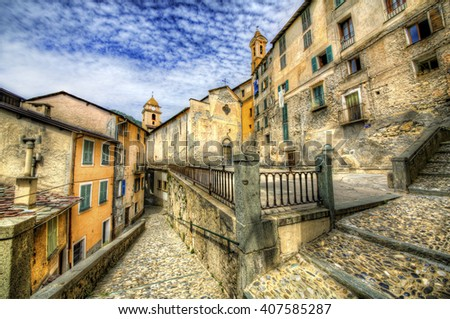 Church Square and the Church of the Holy Savior in Saorge, Alpes-Maritimes, Provence, France - stock photo