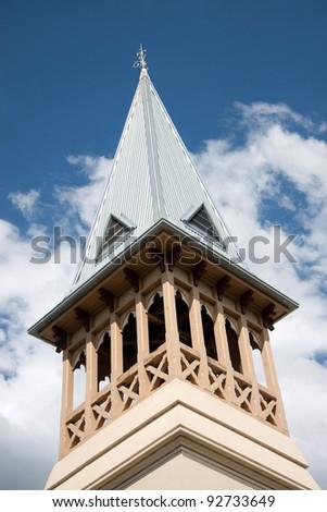 Church steeple against blue sky - stock photo