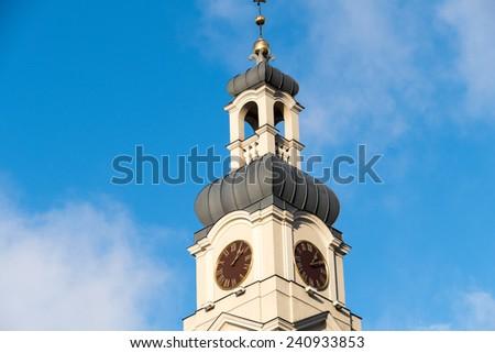 church tower against the blue sky, riga, latvia - stock photo