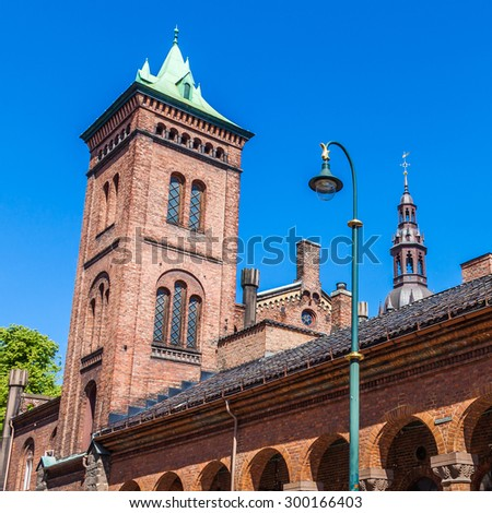 Church tower and rooftops in Oslo, Norway. - stock photo
