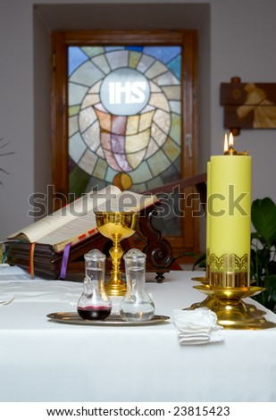 church utensil on an altar before stained-glass windows - stock photo