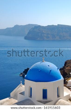 Church with Mediterranean sea background in Oia (Santorini Island - Greece) - stock photo