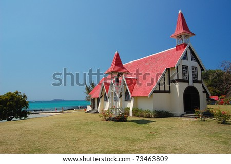 Church with red roof on seashore in Cap Malheureux on Mauritius Island - stock photo
