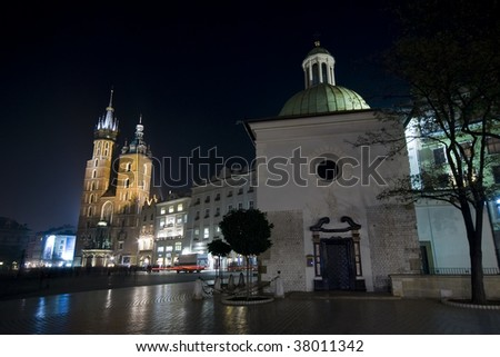 Churches of St Mary and St Adalbert on the Krakow main square at night - stock photo