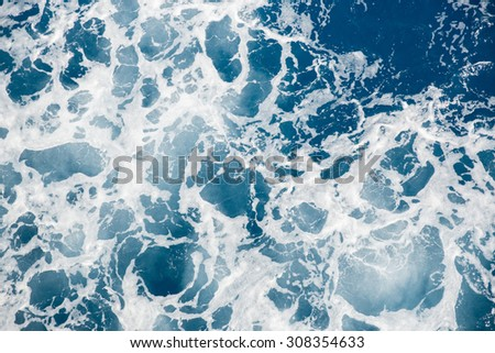 Churning water in the sea - stock photo