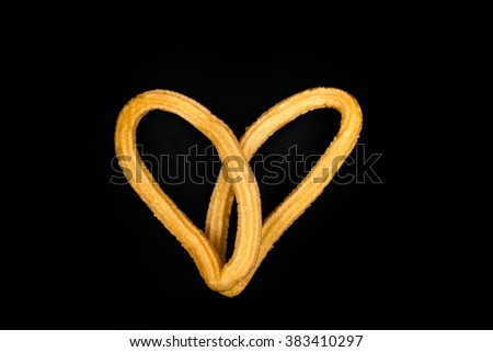 Churros in the shape of a heart - stock photo