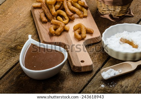 Churros with chocolate dip - Streed food, deep fried, delicious, but heavy street food. - stock photo