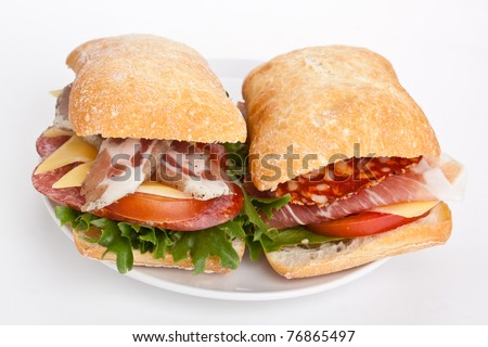 Ciabatta bread sandwiches stuffed with meat, cheese and vegetables on ...
