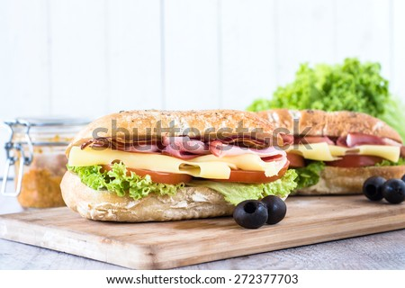 Ciabatta sandwich with bacon and cheese on wooden boarde,selective focus and blank space  - stock photo