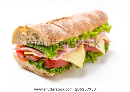 Ciabatta Sandwich with Lettuce, Tomatoes, Ham and Cheese cut in half - stock photo