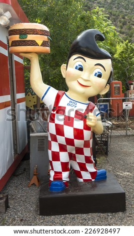 CIBOLA COUNTY, NEW MEXICO - OCTOBER 6, 2014: Bob's Big Boy mascot statue in an antique store in Cibola County, New Mexico. Bob's Big Boy is a restaurant chain founded in Southern California in 1936.  - stock photo