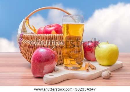 Cider - hot apple beverage on wooden table - stock photo