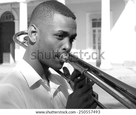 CIENFUEGOS, CUBA, DECEMBER 9: portrait of a cute young musician of a fanfare in the center of the town , on december 9, 2014 in Cienfuegos, Cuba. - stock photo