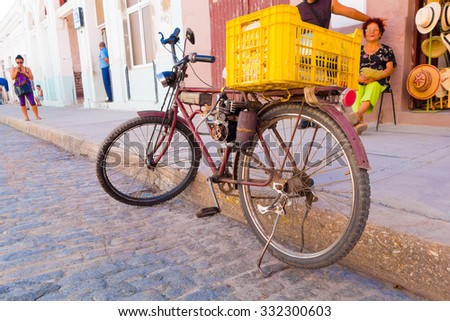 CIENFUEGOS, CUBA - SEPTEMBER 12, 2015: home made pedal assisted gas powered bicycle. - stock photo