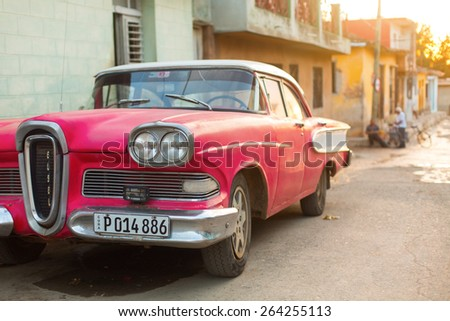 CIENFUEGOS - FEBRUARY 23: Streets of Cienfuegos with classic old car on streets on February 23, 2015 in Cienfuegos. Old American cars are iconic sight of Cuba street. - stock photo
