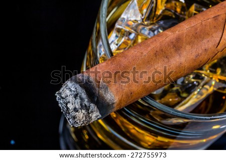 cigar and whiskey. a symbol photo for addiction and related - stock photo