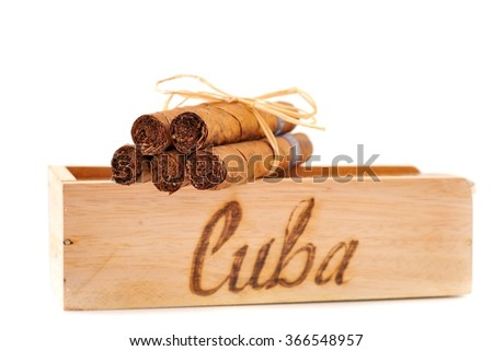 Cigar. Cigars and wooden box, closeup. Cuba cigars.  - stock photo