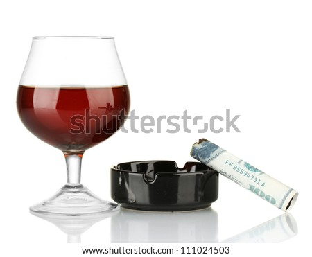 Cigar of the 100 dollar bill and an ashtray and glass of brandy isolated on white - stock photo