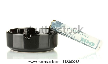 Cigar of the 100 dollar bill and an ashtray isolated on white - stock photo