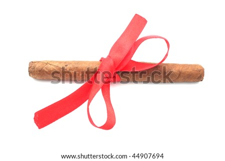 Cigar tied with a ribbon. Isolated object. - stock photo