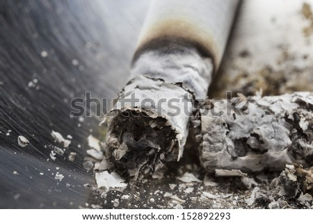 cigarette ash in the foreground - stock photo