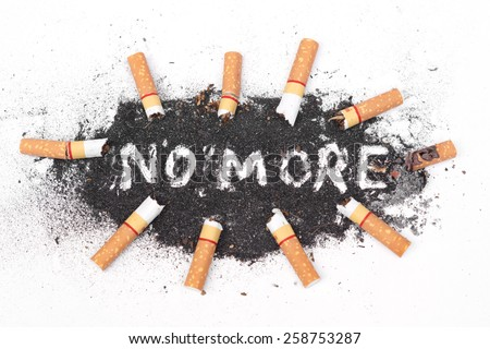 cigarette ash with text saying no more - stock photo