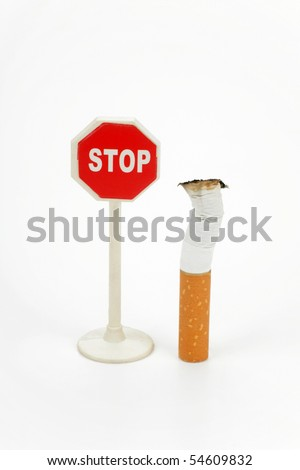 Cigarette butt and sign stop isolated on white background - stock photo