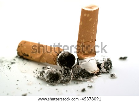 Cigarette butts on white background - stock photo