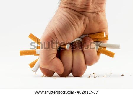 cigarette fist - stock photo