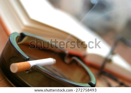 Cigarette in ashtray - close-up - stock photo