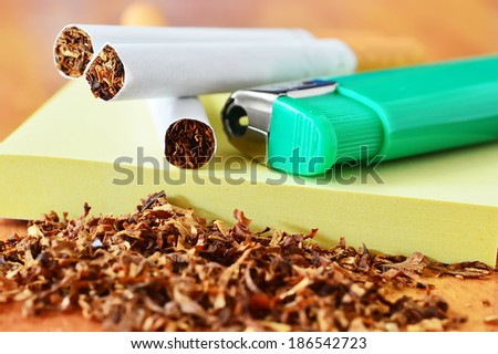 cigarette, lighter green and tobacco isolated - stock photo