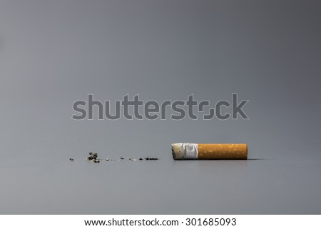 Cigarette on gray background - stock photo