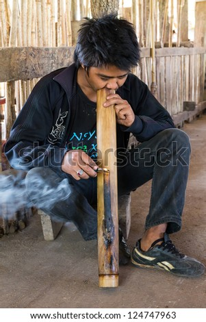 Cigarette smoking or marijuana in Northern Thailand - stock photo