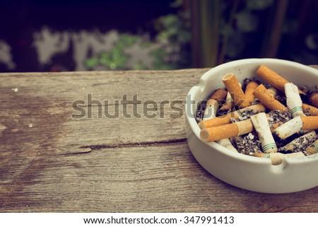 cigarette stub in ashtray, image no smoking concept background - stock photo