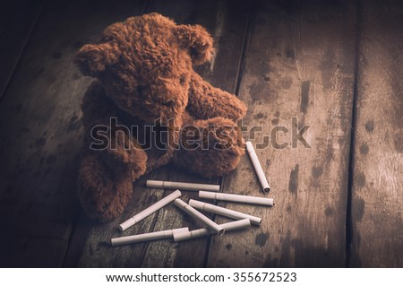 cigarette with teddy bear no smoking day concept - stock photo