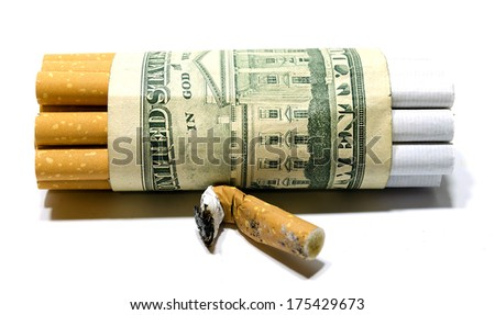 Cigarettes and dollar as a concept of smoking costs - stock photo