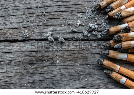 Cigarettes closeup on wood background texture with copy space. World no tobacco day background. Stop quit smoking background. - stock photo