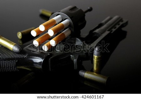 CIGARETTES REPRESENTS BULLET OF A REVOLVER.  - stock photo