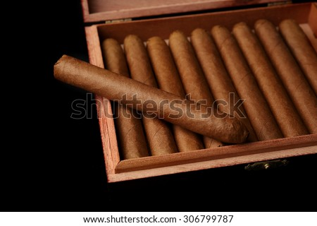 Cigars in box on table, closeup - stock photo