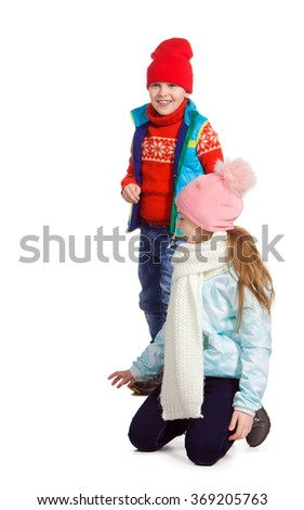 Cildren playing in the snow, isolated on white background. Children in winter. Happy kids playing snowball  - stock photo