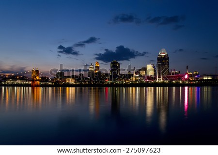 CINCINNATI - MAY 02: Scenic Cincinnati skyline and Ohio river shortly after sunset on May 2, 2015. Cincinnati is the 3rd largest city in Ohio and 65th largest city in the USA. - stock photo