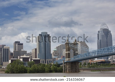 Cincinnati riverfront shot from Kentucky with the John A. Roebling suspension bridge. - stock photo
