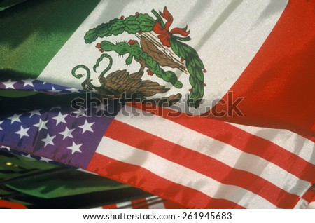 Cinco de Mayo, a Mexican/American holiday, on Olvera Street, Los Angeles, CA shows Mexican and American Flag, two nations sharing one border.  - stock photo
