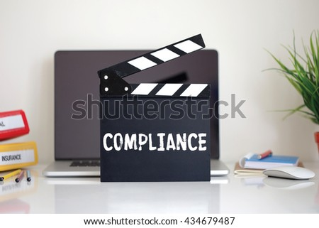 Cinema Clapper with Compliance word - stock photo