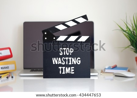 Cinema Clapper with Stop Wasting Time word - stock photo