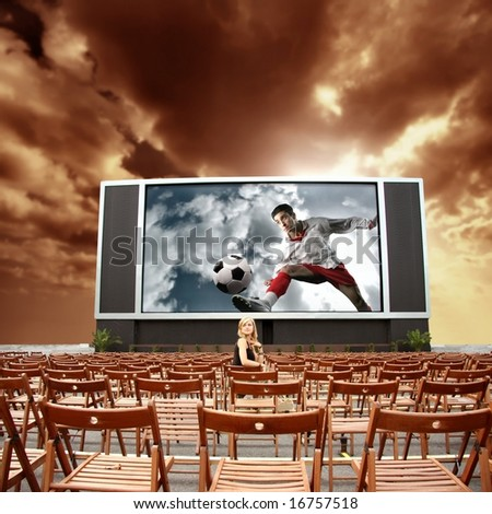 cinema outdoor and  a woman - stock photo