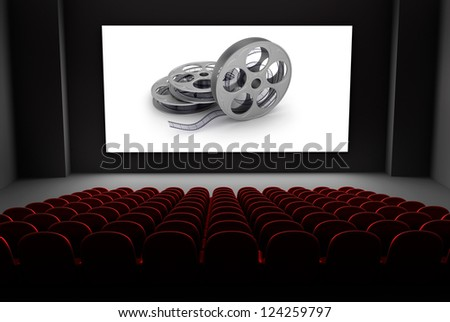 Cinema theater with reels of film on the screen. - stock photo