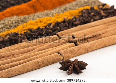 Cinnamon and spices on white background - stock photo
