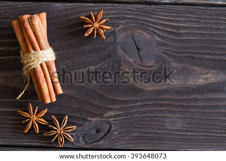 cinnamon and star anise on a wooden background . close-up. Top view  - stock photo