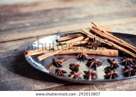 Cinnamon and star anise seeds on a wooden background with shallow depth of field. Bright still life photo of spices.  - stock photo